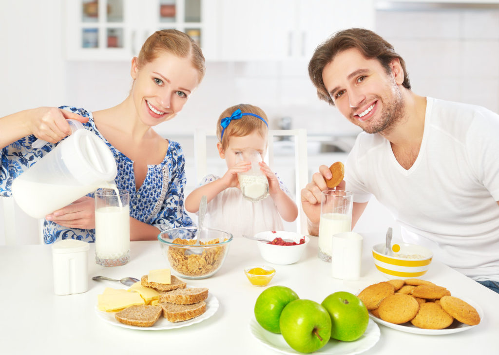 Weaned child eating with the family